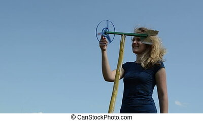 woman play pinwheel - beautiful woman play with spinning...