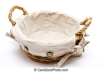 Basket with cloth on white background