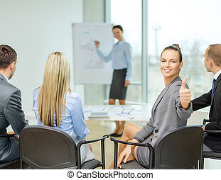 businesswoman with team showing thumbs up - business, office...