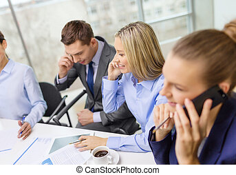 business team with smartphones having conversation -...