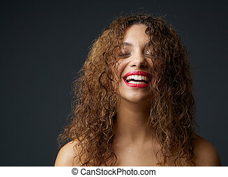 Portrait of a young african american woman laughing