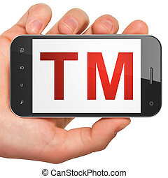 Law concept: Trademark on smartphone - Law concept: hand...