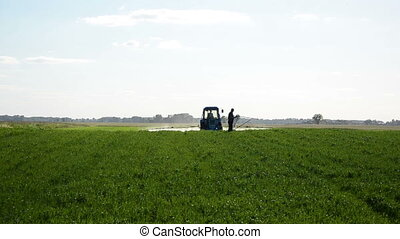 tractor spray man meter - Tractor spray field with chemicals...