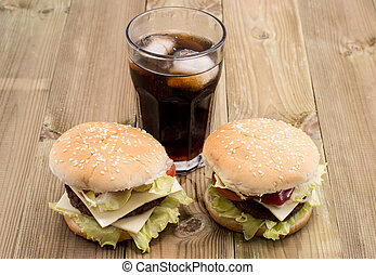 Two Burger with Softdrink on wood