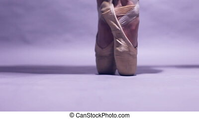 Ballet shoes - View of a ballerina standing en pointe on the...