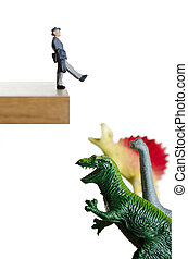 Walking into disaster - Business figurine walking off a...