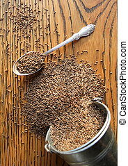 Cumin seeds on wooden background