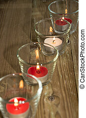 Candles in glasses at daylight - Candles in glasses on...