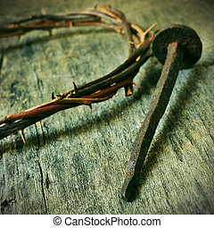 the Jesus Christ crown of thorns and a nail on the Holy...