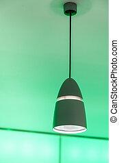 Green light - Ceiling luminaire on the illuminated green...