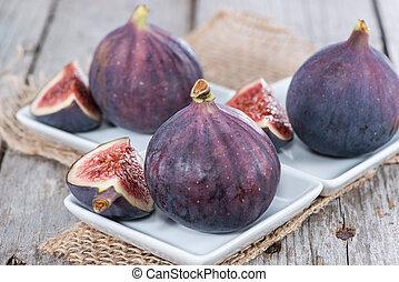 Some fresh Figs on wooden background