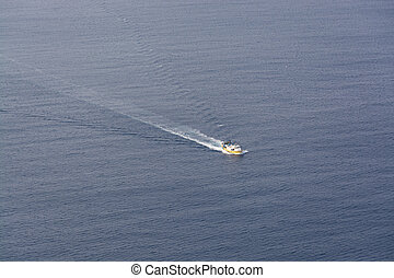 Fishing boat birds eye view - Yellow fishing boat on vast...