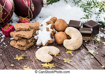 Mixed Christmas Sweets with snow in the background