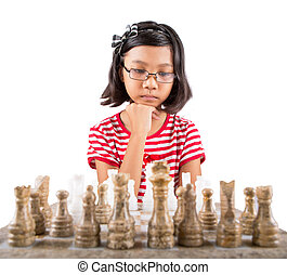 Little Girl Playing Chess - Little girl playing stone made...