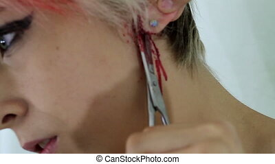 Self mutilation cutting  - woman self mutilation cutting ear