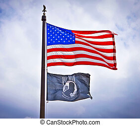 American and POW flags - American and POW flags flying on...