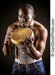 bombom - African american man posing with his drum. Over...