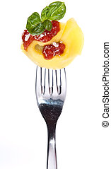 Tortellini on a fork isolated on white - Tortellini on a...