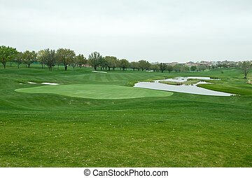 A bright green golf course - An image of a bright green golf...