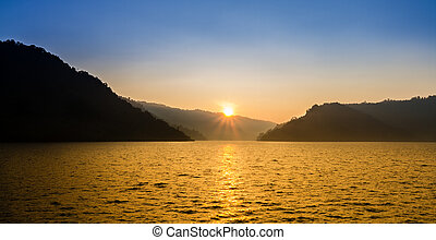 Nice sunrise over mountain and lake