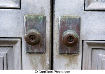 Tarnished vintage door knobs - A close up image of tarnished...