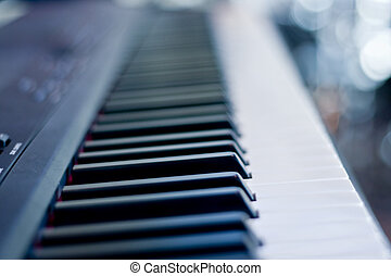 Black Keys Closeup - Closeup of a piano keyboard focused on...