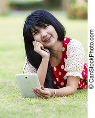 Young woman using her tablet pc