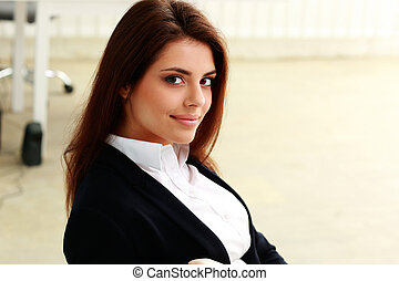 Closeup portrait of a young happy businesswoman in office