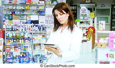 Doctor in pharmacy working - Beautiful doctor in pharmacy...
