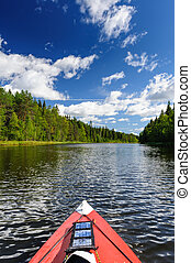 Kayaking in the river in Karelia, at the north of Russia