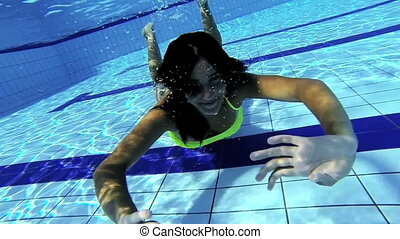 Beautiful girl underwater happy
