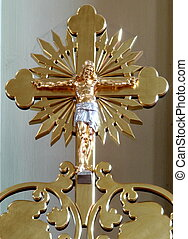 Golden holy cross with figure of crucified jesus christ
