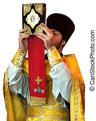 Ukranian Orthodox priest rising ancient Holy Gospel