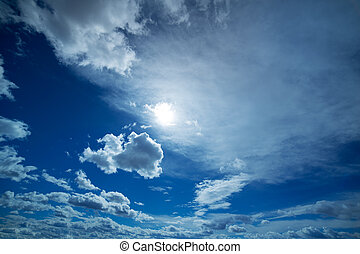 blue and dramatic clouds sky in winter background
