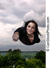 Woman Flying Through the Sky - Beautiful young woman flying...