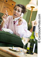Young woman at home talking on telephone