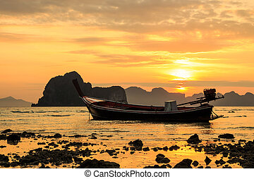 boat and sunrise - boat on beach and sunrise in summer at...