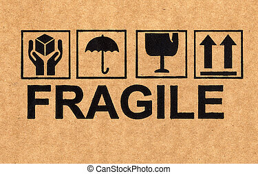 fragile symbol on cardboard - fine image close up of fragile...