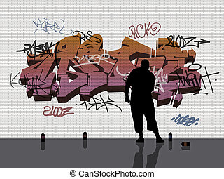man tagging a white brick wall