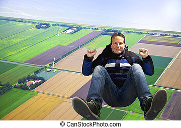 Man jumping out of plane with parachute