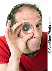 eye of inspection - man holding magnifying lens on right eye...