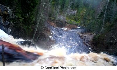 waterfall and rough river - big waterfall in autumn among...