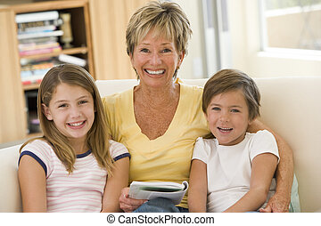 Grandmother reading with grandchildren.