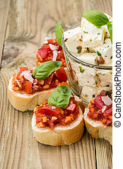 Bruschetta with Feta Cheese against wooden background