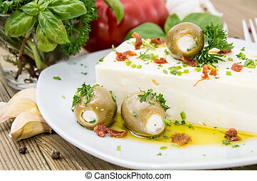 Feta Cheese with Olives and oil on wooden background