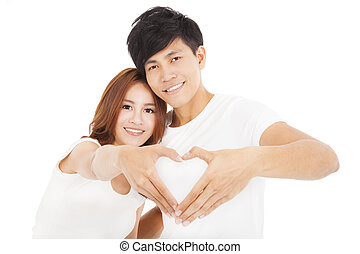 Young couple  making heart shape by hands