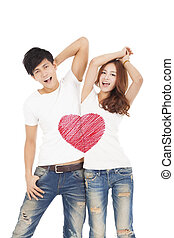happy couple with love heart symbol design on the whit t shirt