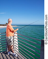 Grandpa Loves to Fish - Senior man relaxing and fishing off...