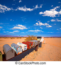 Grunge mail boxes in California Mohave desert USA - Grunge...