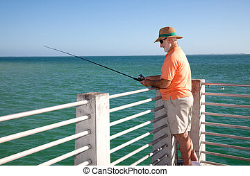 Senior Fisherman Horizontal - Senior man in straw hat...